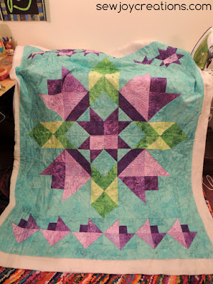 spring quilt full over ironing board