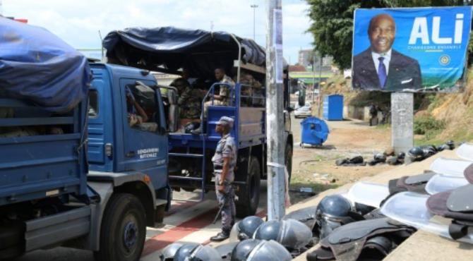 Gabonese security forces deployed next to a campaign poster of President Ali Bongo in Libreville on September 23, 2016. By Samir Tounsi (AFP). Libreville (AFP) - Libreville's nearly empty streets were under the watch of a heavy police and military presence on Saturday after Gabon's top court upheld President Ali Bongo's re-election in bitterly disputed polls.  Security force checkpoints dotted routes into the capital's centre, helicopters hovered overhead and elite troops protected the presidential palace, but no violence had been reported.  The Constitutional Court, while partially changing the results of the close August 27 vote, said Bongo maintained a lead over his former ally-turned-opponent Jean Ping, at a televised public hearing overnight Friday-Saturday.  Bongo took 50.66 percent of the vote against 47.24 percent for Ping, the court ruled, putting his margin at 11,000 -- higher than the less than 6,000 initially announced.