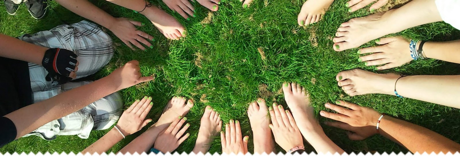 hands and feet together on grass