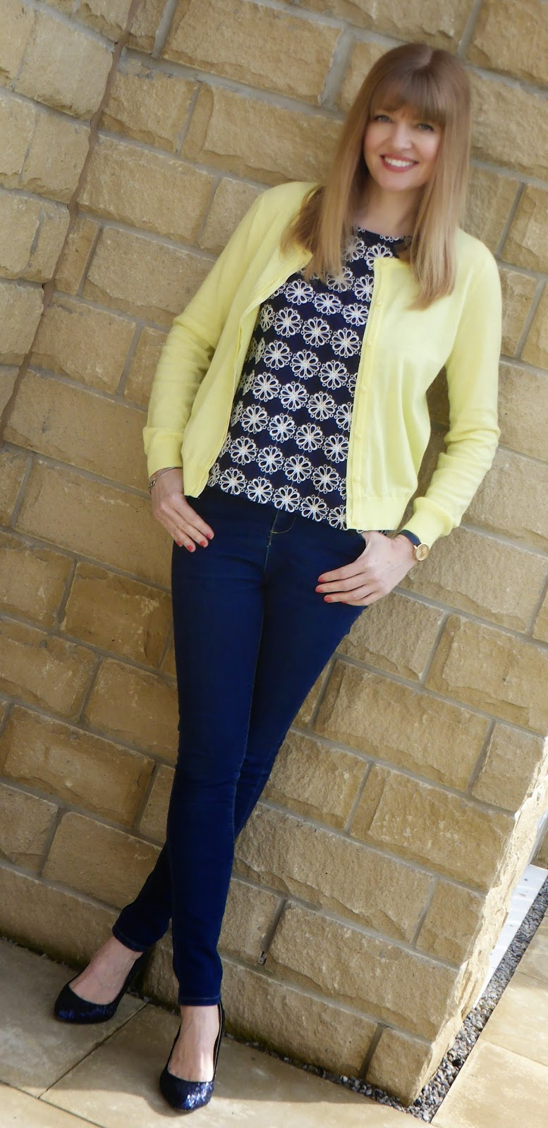 Over 40 Fashion blogger What Lizzy Loves. Navy Boden broderie top, lemon yellow cardigan, skinny jeans and navy sequin court shoes