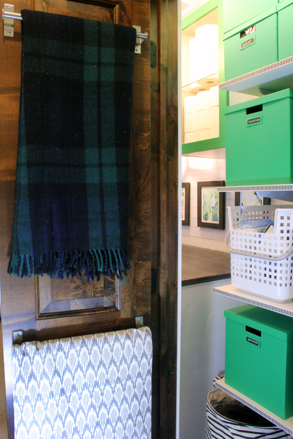 Linen Closet Organization Blankets on back of door
