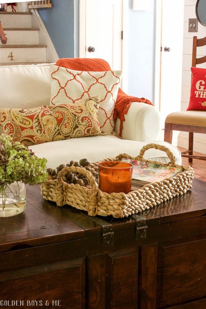 Pottery Barn beachcomber basket on coffee table in family room with white slipcovered Ikea sofa