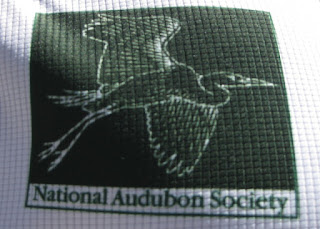 National Audubon Society logo on the back of the designer's bike jersey.
