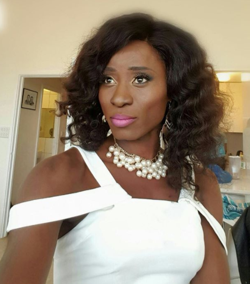 Photo of Bisi Alimi dressed up as a Lady.