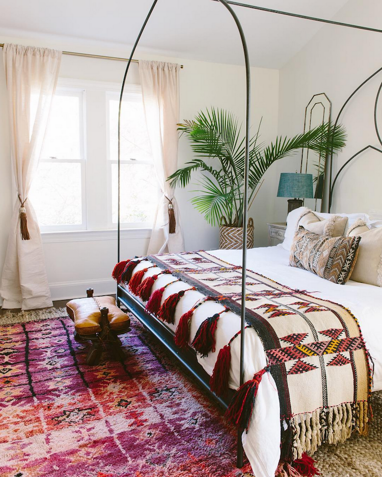bohemian chic house, oriental rugs, cactus, houseplants, gold mirror, bedroom