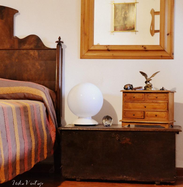 decoración de un dormitorio con vigas de madera, una habitación muy especial con dos vestidores