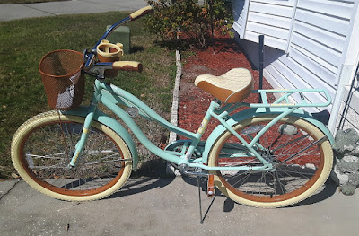 Turquoise touring bike with a retro style.