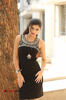 Actress Poojitha Pallavi Naidu Stills in Black Short Dress at Inkenti Nuvve Cheppu Movie Platinum Disc Function  0140.JPG