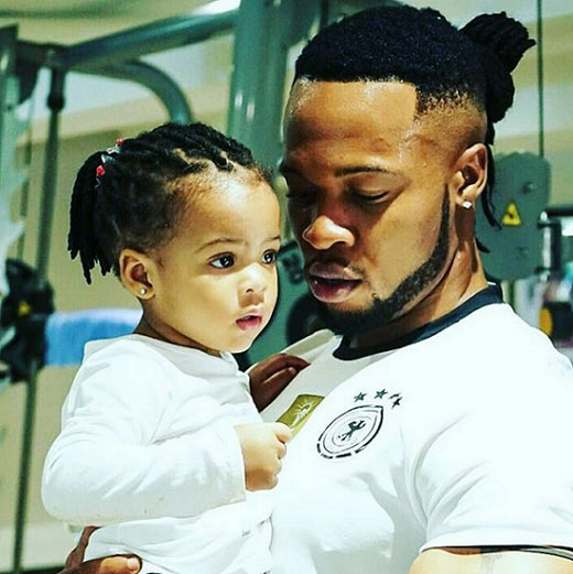 Flavour cuddles his daughter in adorable father-child moment