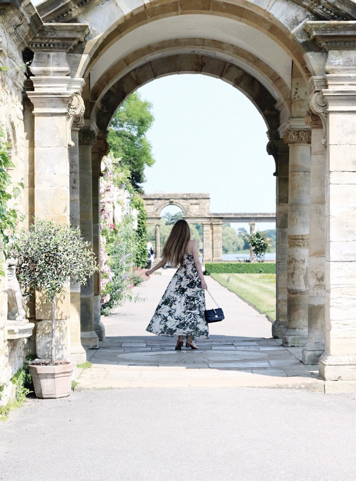 Twirling in Archway of Italian Garden