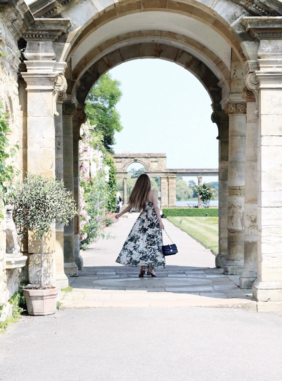 Twirling in Archway of Italian Garden