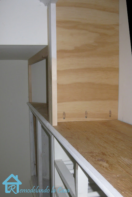 short cabinets in laundry room brought all the way to the ceiling