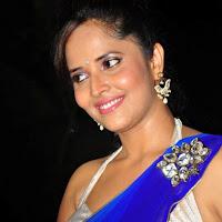 glorious hot exotic Anchor anasuya sexy in blue saree