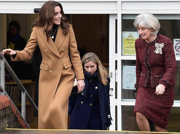 Kate Middleton wore massimo dutti cashmere wool camel coat. Kate Middleton wore Zara animal print skirt at Ely and Careau Children's Centre