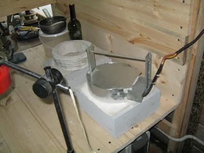 вид на печь утепленную асбестом, контроллер сверху за кадром
