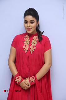 Actress Poorna Latest Stills in Red Dress at Rakshasi First Look Launch  0060.JPG
