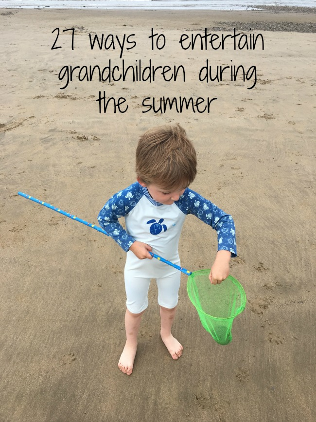27-ways-to-entertain-grandchildren-during-the-summer-text-over-image-of-child-on-beach-with-fishing-net
