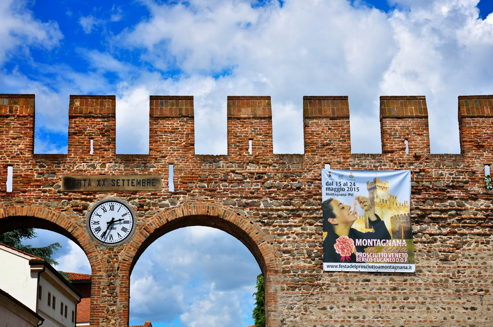 The poster for the Prosciutto festival on the defensive wall of Montagnana, Veneto, Italy