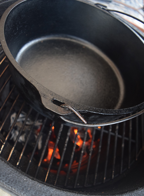 Preheating a Lodge cast iron dutch oven on a ceramic kamado grill like the green egg, Grill Dome, or Primo.