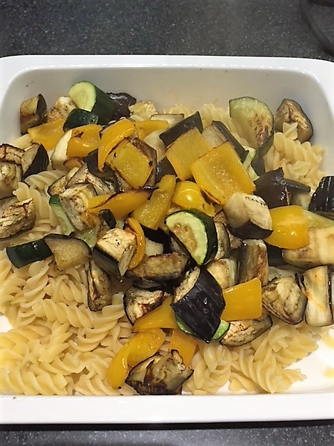White Casserole Dish filled with pasta and roasted veg