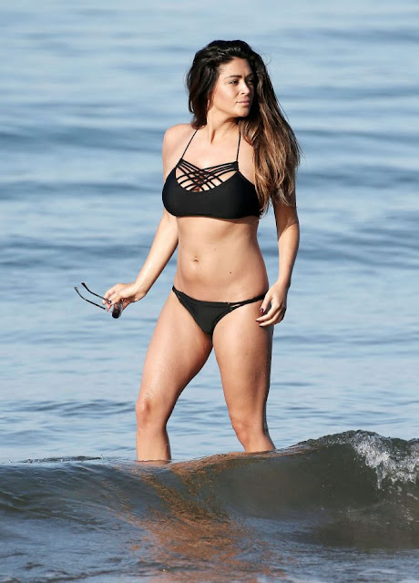 Casey Batchelor in Black Bikini on a beach in Marbella