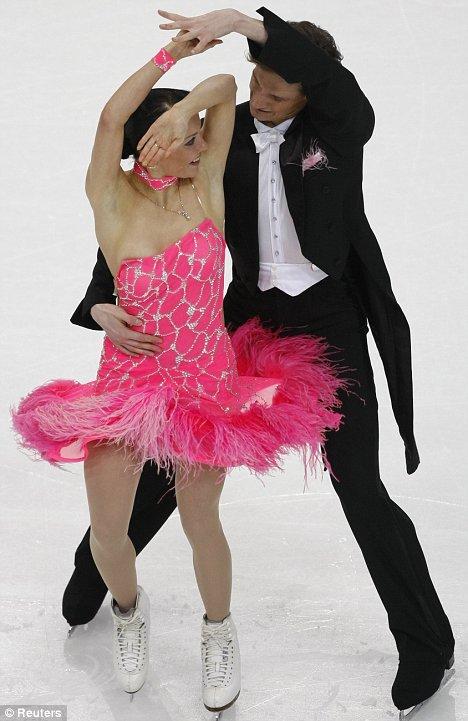 Ekaterina Rubleva's dress slips down as Ivan Shefer raises her hand at the European Figure Skating Championships in Helsinki