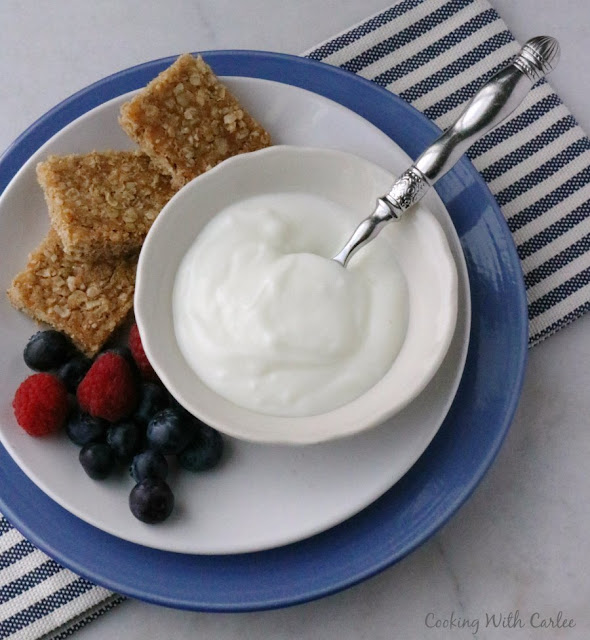 brown sugar oatmeal squares with bowl of yogurt and fresh fruit
