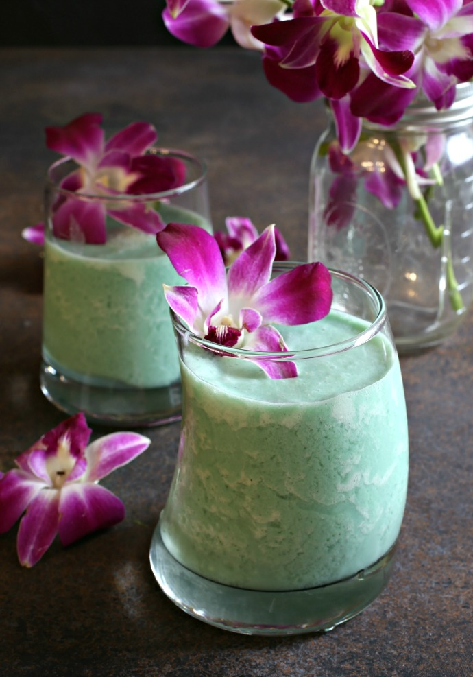 Frozen rum cocktail flavored with pineapple juice, blue curacao and coconut ice cream.