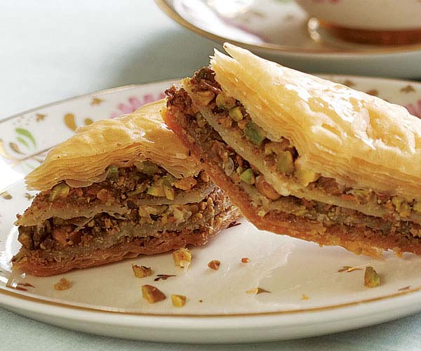 Baklava with pistachios in a serving dish