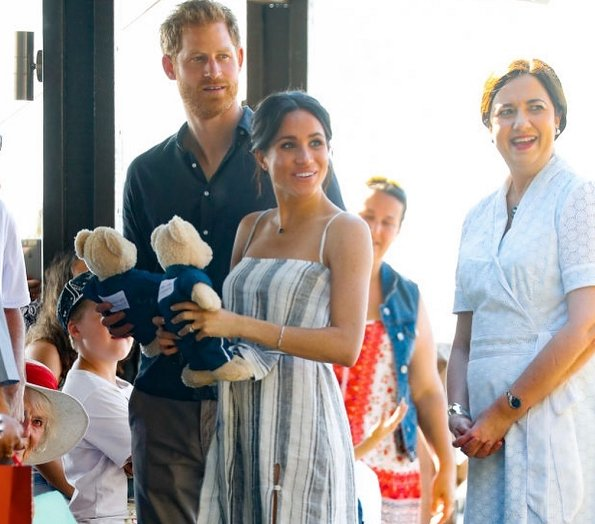 Meghan Markle wore Reformation Pineapple Dress and Sarah Flint Grear Lace Up Sandals. Adina Reyter three diamond amigos curve post earrings