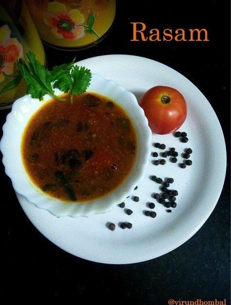 Rasam - In South Indian cuisine, there is nothing simpler than a rasam. Rasam is prepared with lots of spices and flavours and just takes a few minutes to prepare with simple process. If you prepare a perfect rasam your tongue will ask you to eat for one more time.The perfect rasam will have a balance of flavours that comes from the garlic, pepper, cumins and coriander leaves. The garlic, pepper and cumins gives the powerful flavour to the rasam. There are a few tricks for cooking a good rasam. The spices   Do not load it with too much of spices for the ground paste. Use all the flavours in minimal amount, so that you can have a nice flavourful rasam.  Do not peel the garlic cloves fully. Just cut the top and then grind it. This is my mother's tip. You will feel the aroma of the garlics, when you taste it.  Tomatoes The tomatoes, add taste and colour to the rasam. It's beautiful to see the chopped tomatoes floating on the top of the rasam. Try to chop the tomatoes finely or give it a gentle crush with your palm before sauteing.  Cooking    Do not allow to boil the rasam for more than 5 minutes. Because it will diminish the flavours. As soon as you finished, close it with the lid.