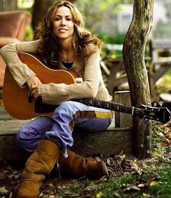 Foto de Sheryl Crow posando con su guitarra