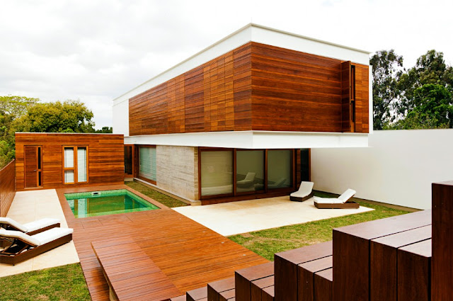 Picture of wooden facade on the house and wooden floors in the backyard