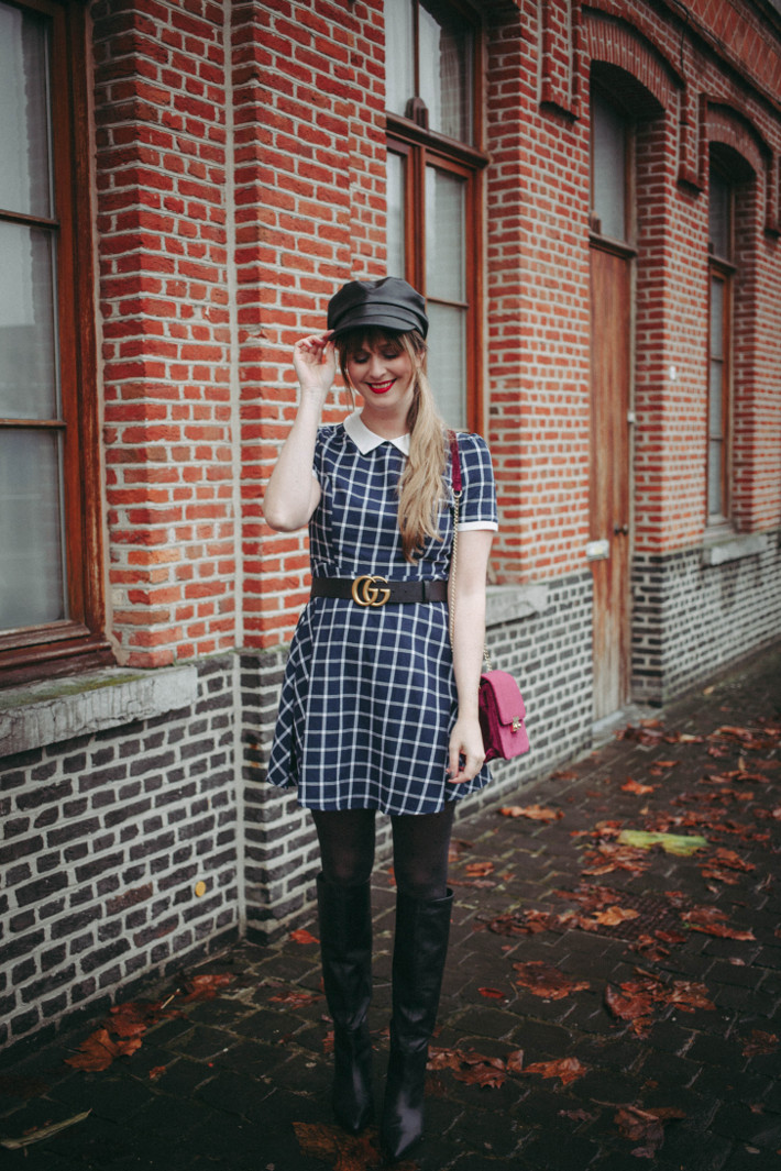 checked dress with contrast collar, gucci belt, velvet purse, polkadot tights, leather fiddler cap