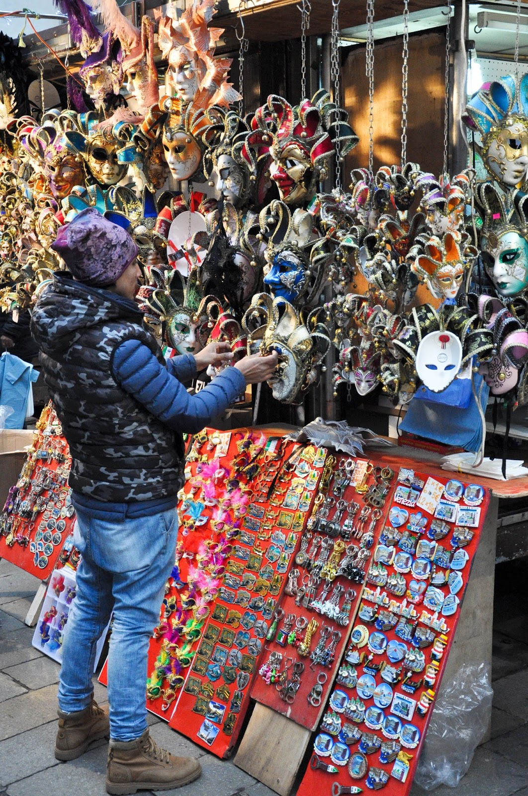 Setting up a cheap souvenir stall, Venice, Italy