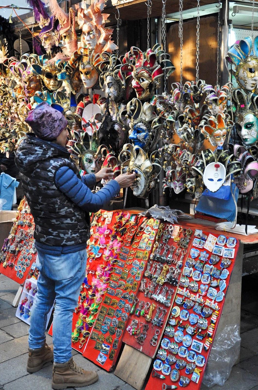 Setting up a cheap souvenir stall, Venice, Italy