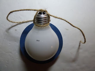 Recycled light bulb ornament for breast cancer awareness