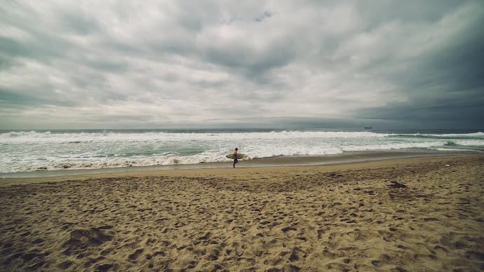 Wallpaper: Surfer, Sandy Beach and Ocean Waves
