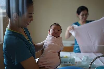 nurse and newborn