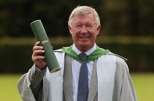 Sir Alex Ferguson poses after being awarded an honorary doctorate degree by Stirling University