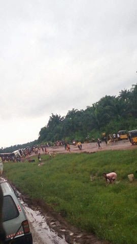 Residents scoop fuel after tanker falls in Abia State capital, Umuahia