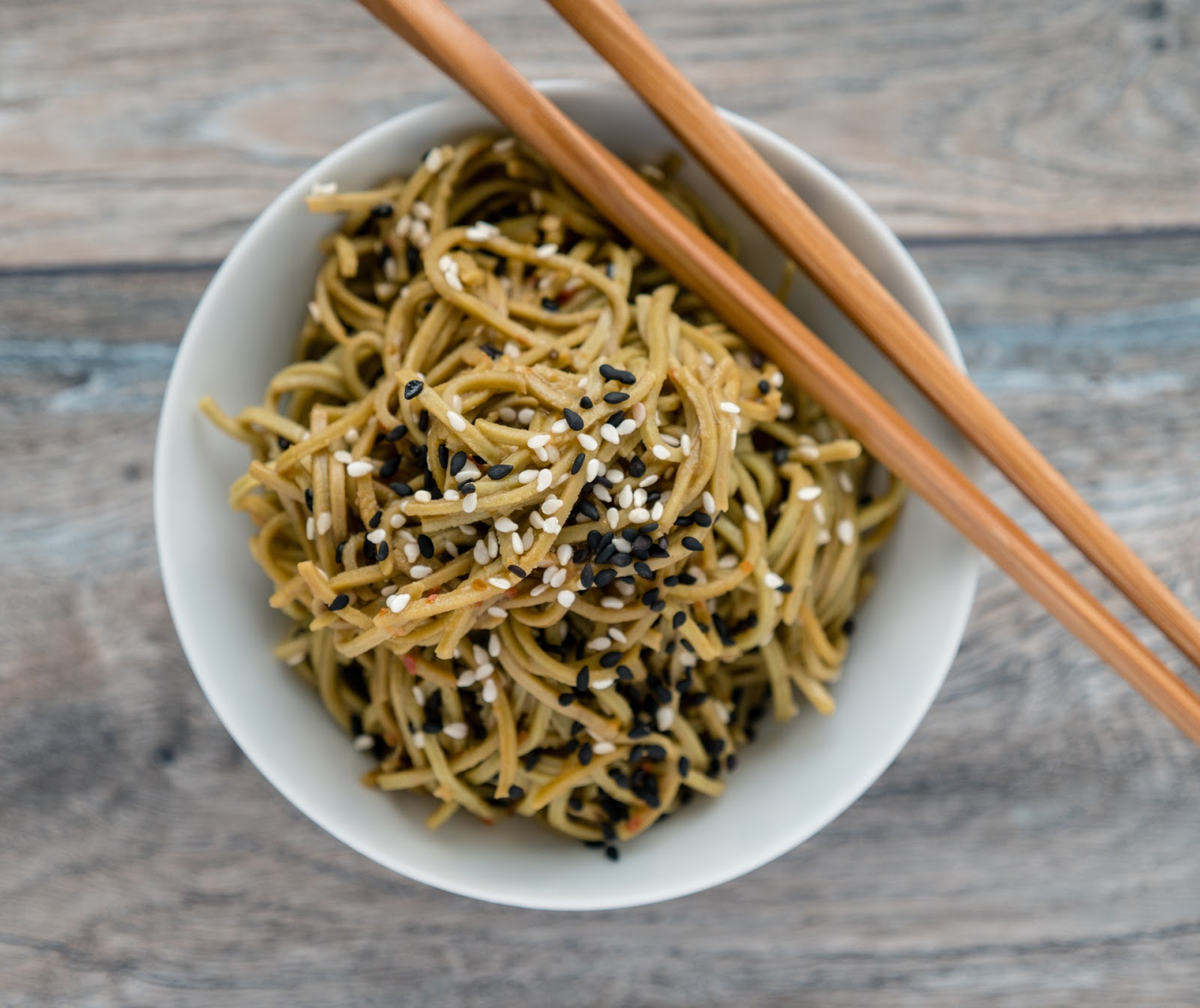 This quick and simple vegetarian sesame ginger edamame spaghetti recipe is packed with protein, low in carbs, and full of flavor. | Local Food Rocks