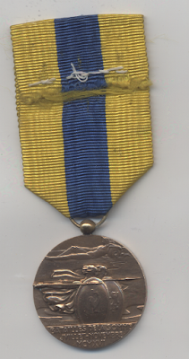 Bronze medal with yellow and blue stripped silk ribbon.  Image shows two soldiers from antiquity holding shields and javelins.  There is a French cockerel and British Lion in the foreground.  Figure lying down at the top of the medal with a water jar above sumbolising the River Somme.