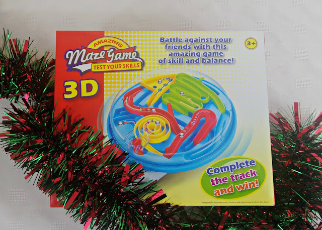 Boxed 3D maze game festooned with tinsel