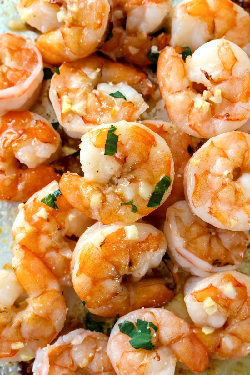 10 Minute Garlic Butter Baked Shrimp is an easy recipe for perfectly cooked, garlicky, buttery shrimp that is baked on a sheet pan in just 10 minutes! #shrimp #sheetpan #seafood