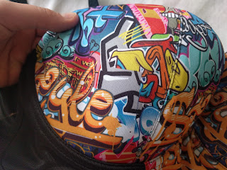Close up shot of the cup of the Graffiti, showing the bright and detailed print