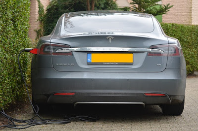 Gray Tesla car charging