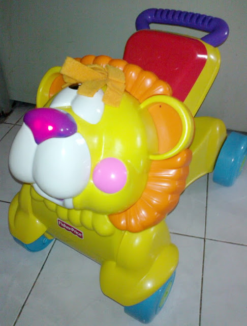 TenderLovingCare Toys: Fisher Price 2in1 Musical Stride-to-Ride Lion (used)