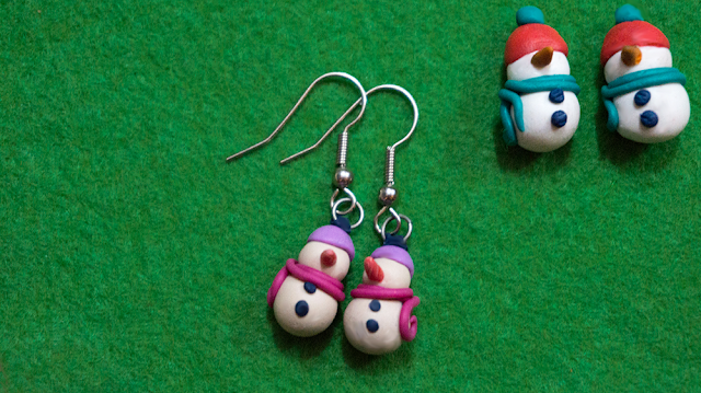 Two pairs of snowman earrings in different colors, one finished an done before baking.
