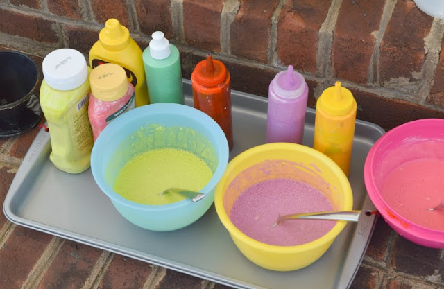 Squirt! Drip! Pour! Process Art Painting For Kids.  Head outside for some messy painting fun for spring our summer.  Preschoolers, kindergartners, and elementary students will LOVE this opportunity to make giant process art.